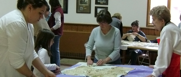 Our Savior's church members making lefse